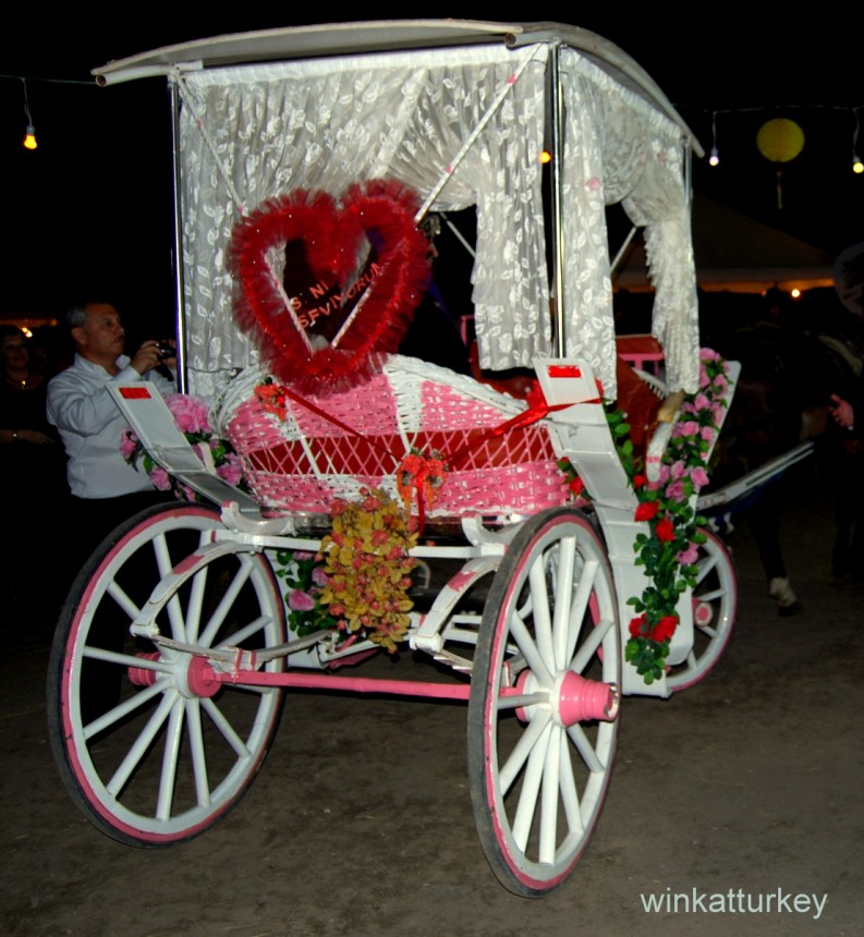 The bride appears in this carriage